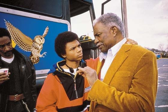 "De'Aundre Bonds and the late actor, Ossie Davis, in ""Get On The Bus"""